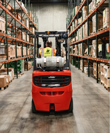 Forklift driving in warehouse